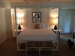 Resort chic room with big four poster bed