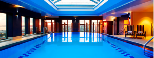 The Sheraton on the Park features an indoor pool with a glass ceiling.