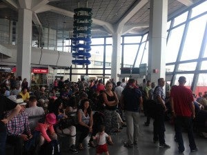 Mini terminal for US bound flights, which was overcrowded.