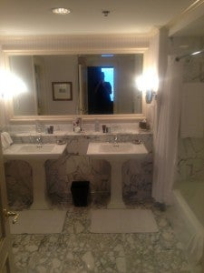 Marble bathroom with double vanity.
