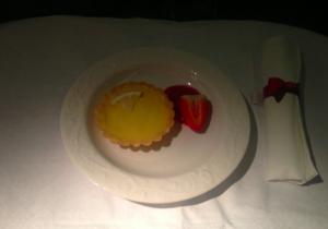 Dessert was a lemon tartlet with strawberry sauce.