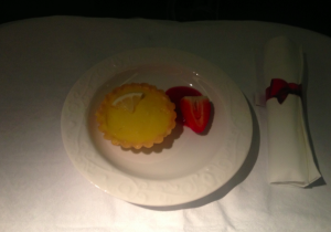 Dessert was a lemon tartlet with strawberry sauce.