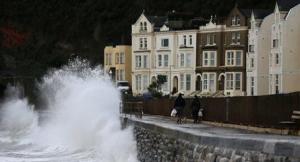 Waves lashed Devon. (Photo credit: Reuters/Stefan Wermuth).