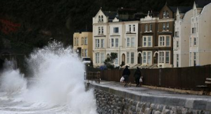 Waves lashed Devon. (Photo credit: Reuters/Stefan Wermuth).