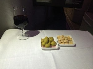 Meal service started with nuts and olives.
