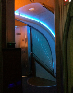 The upper deck is separated from Economy and Business Class by a staircase.