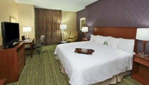 A guestroom at the Hampton Inn and Suites Downtown Denver.
