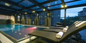Relax at the indoor pool in the Radisson Blu Milan.