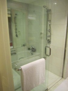 The bathroom had a glassed-in marble bath/shower suite.