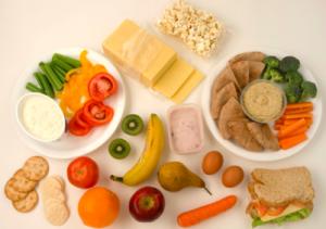 Pack healthy snacks like fruit, nuts or veggies.