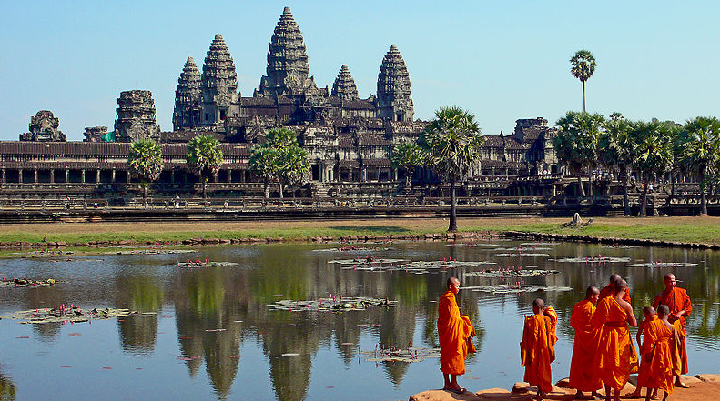 Buddhist monks gather at the temple of Angkor Wat.