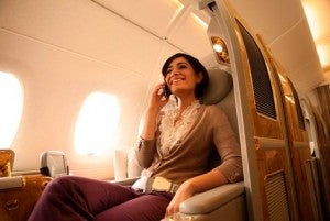 Happily chatting on the phone during an Emirates flight.