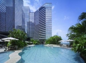 Relax in the pool at the Grand Hyatt Hong Kong.
