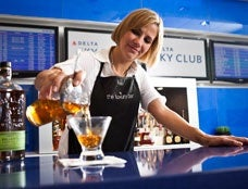 Have a beer at the Delta Sky Club.