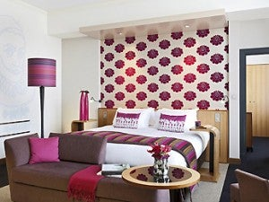 A brightly decorated guestroom at the Sofitel Amsterdam.
