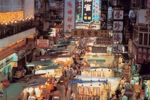 Enjoy shopping and street food at the Temple Street Night Market.