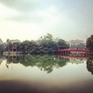 Although Hanoi is Vietnam's second largest city, it's also filled with green spaces to relax in, like Hoan Kiem lake with its famous scarlet bridge.