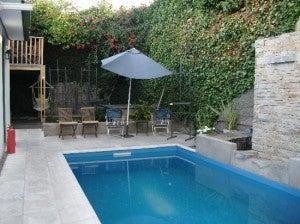 The swimming pool at the Bohemia Hotel in Mendoza.