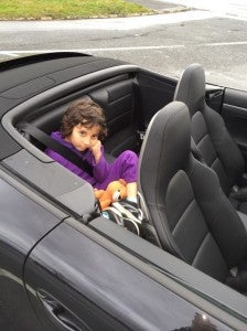 Clearly my daughter was not thrilled to be stuck in the back seat.
