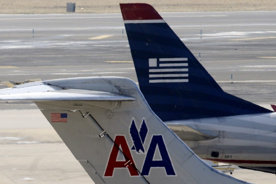 You can officially get US Airways  miles by flying American.
