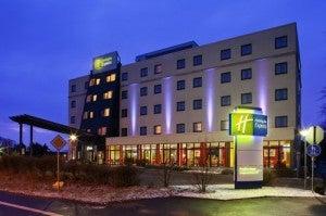 The exterior of the Holiday Inn Express Frankfurt.
