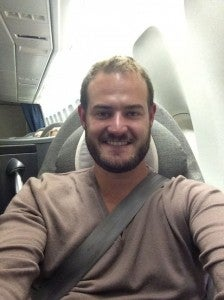 All buckled up in United GlobalFirst LAX-SYD. They make you buckle a shoulder hardness for takeoff/landing
