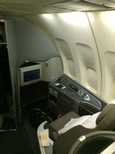 I got settled into my seat, 1K.