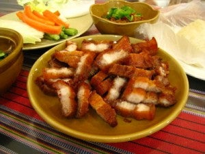 Try authentic Thai Moo Tod, or deep fried pork.