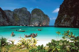 Phuket beaches are famous for stunning white sand and clear blue green water.