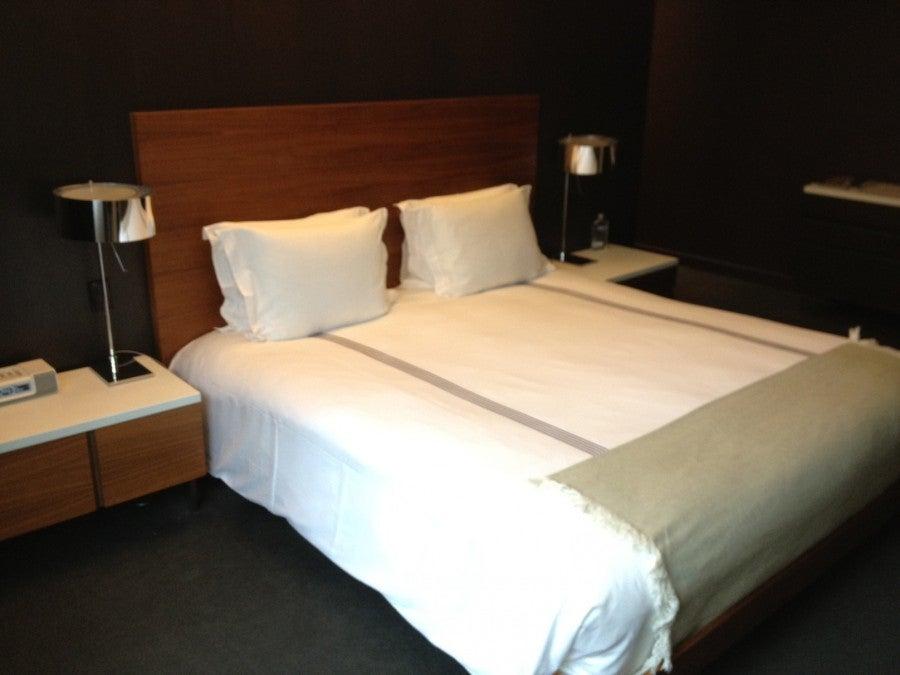 My Queen Superior room bed.