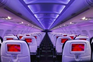 Virgin America's Economy seating comes with seat-back screens and mood lighting
