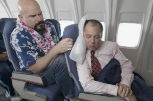 This is how I feel on flights sometimes...sans lei of course...
