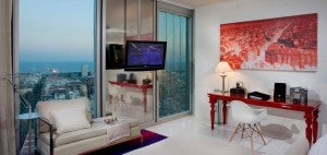 Guestrooms at the Melia Barcelona Sky (like this loft room) afford great city and sea views, and include artwork made by local artists