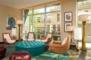 The jewel-toned lobby of the Hotel Indigo New Orleans, in the Garden District