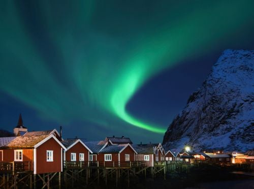 The Aurora from a traditional stilted fisherman's house in Nusfjord, Loften Islands, Norway.