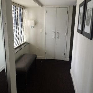Hallway towards the door, with wardrobe at the end