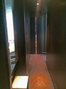 Behind the bed in my suite ran a long hallway with a vanity area