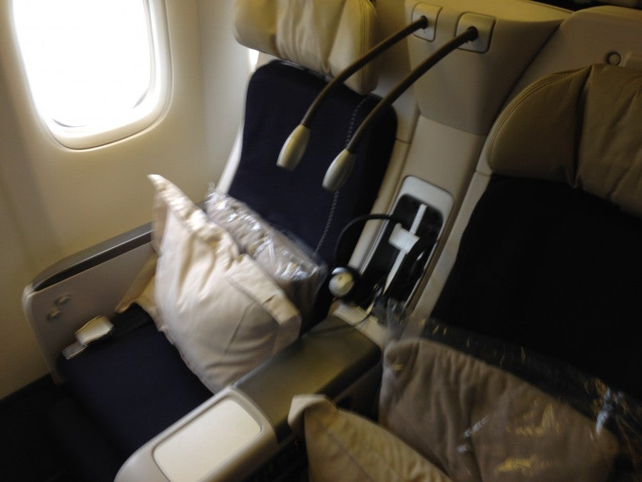 Premium Economy seat with reclining back, reading lights and additional amenities