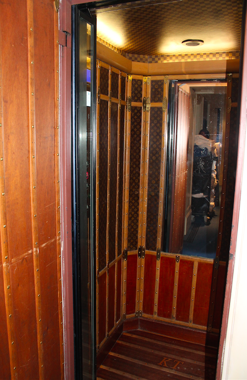 A tiny elevator or a nicely appointed closet, you decide...