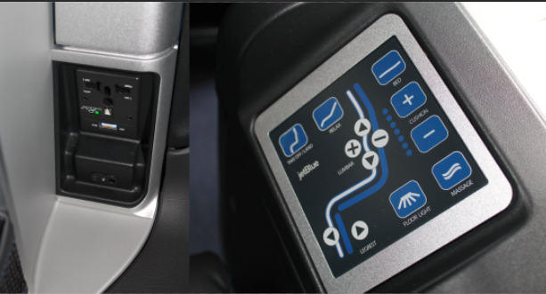 One of the three power outlets and the seat control panel