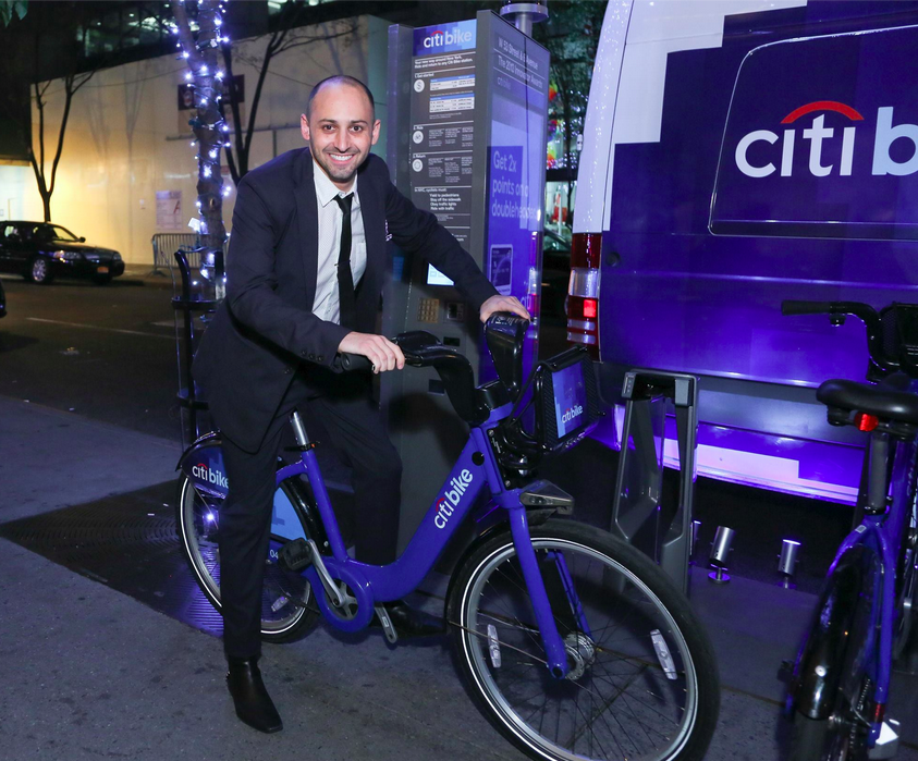 Me rocking out on a Citi Bike. Formal attire is not necessary for riding, but a helmet is recommended.