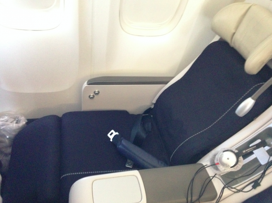 "My seat, while ""fully-reclined"" was not the most comfortable, but better than an economy seat any day of the week."
