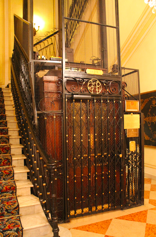 The old-world elevator at the St. Regis Grand Rome, one of the oldest in Europe