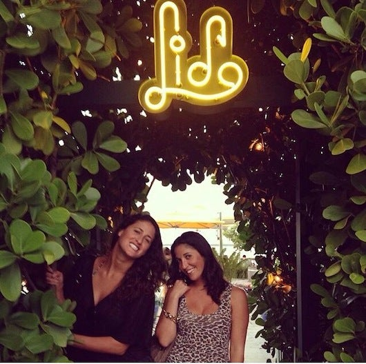 Lifestyle Editor Shayne Benowitz (right) enjoying sunset cocktails at The Standard with her sister Kristy