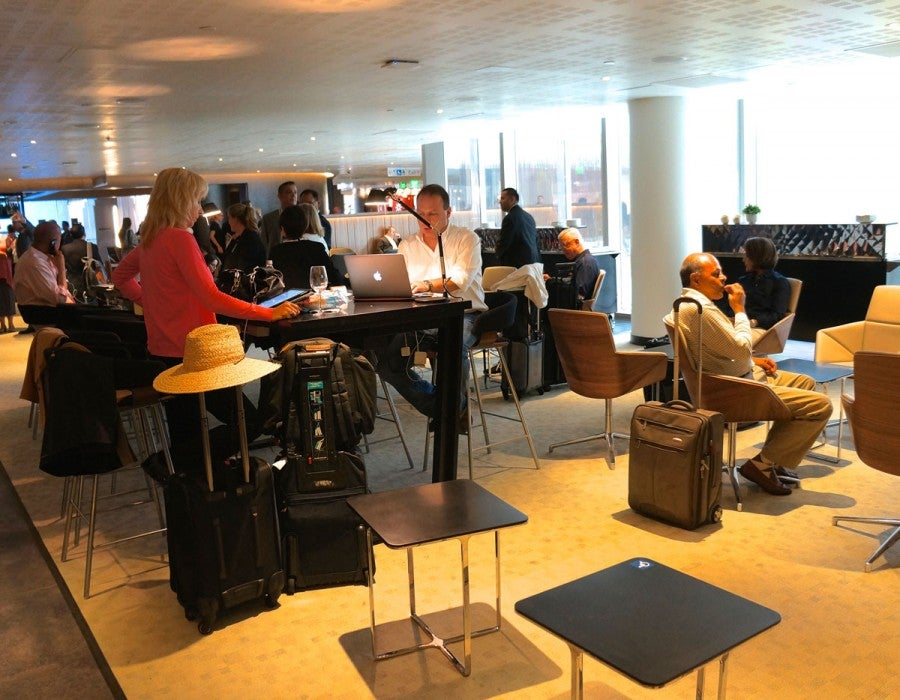 There are several different types of seating areas in the lounge, including a high table for working or eating