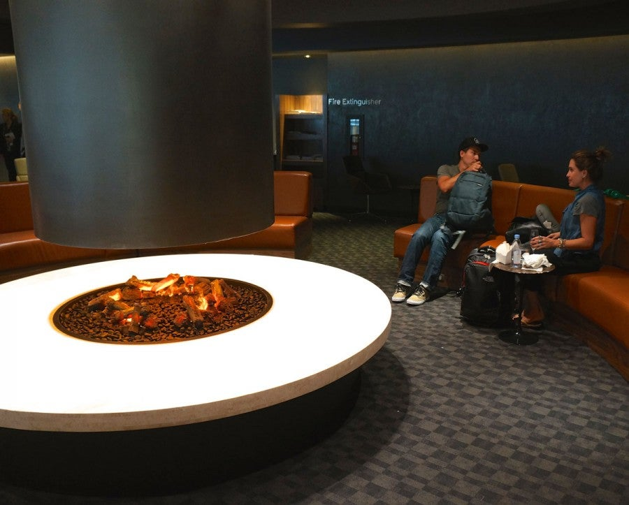 The gas firepit, a play on the hanging fireplaces of the 1960s, is ringed by a circular couch