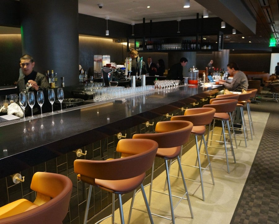 The oneworld lounge's full bar features hand-crafted cocktails and premium wines