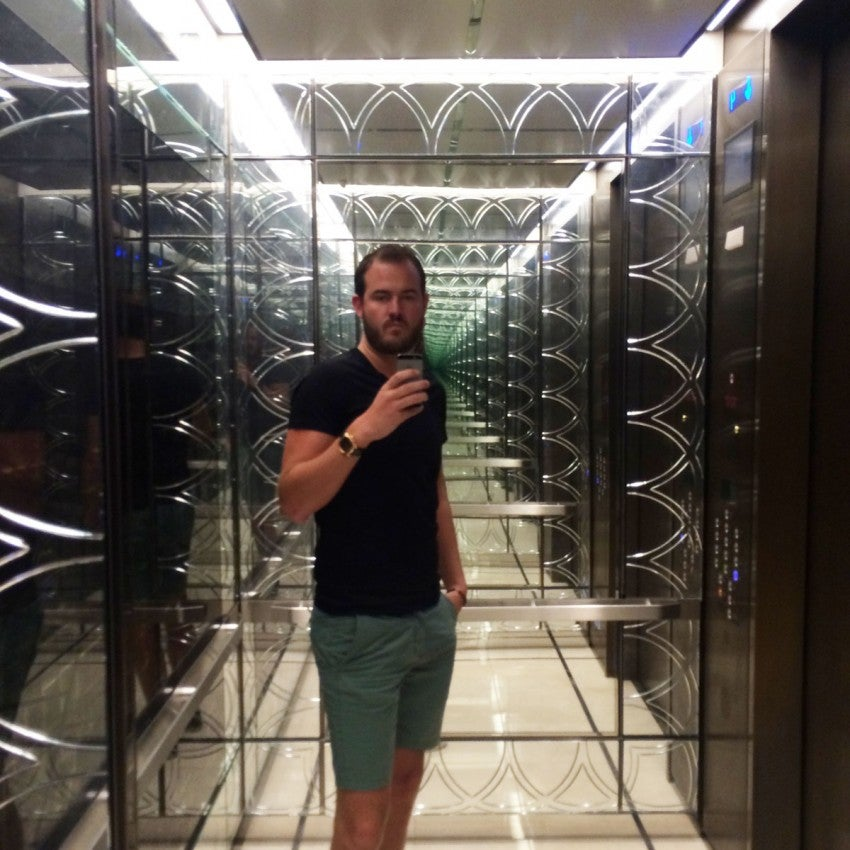 Yours truly in The Langham Chicago's mirrored, Deco-style elevators