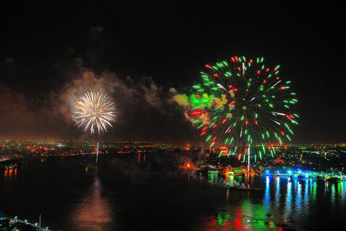 """The 4th of July """"Dueling Barges"""" on either side of the Mississippi in New Orleans"""