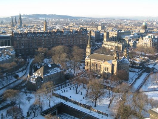 A wintery view of Edinburgh from the castle in wintertime